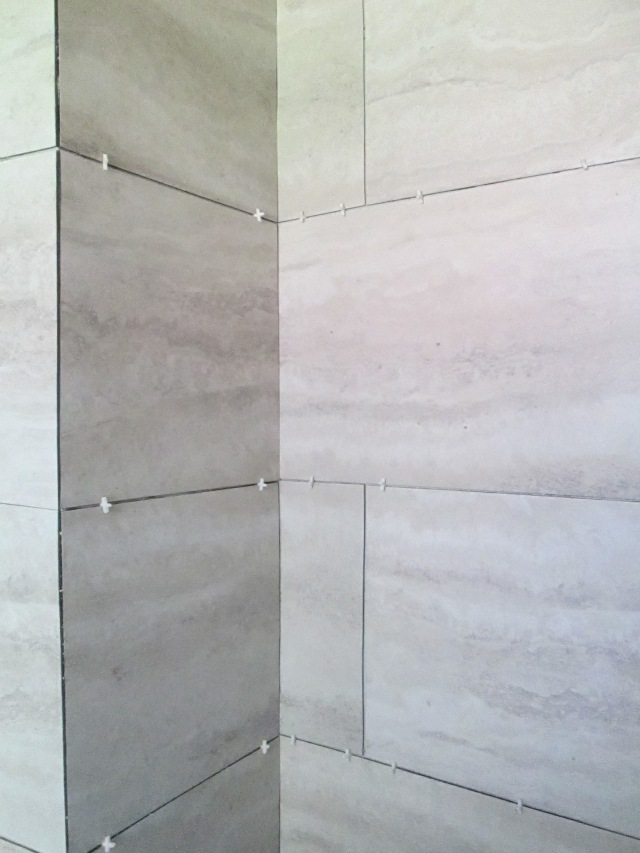 My first wall with the tile spacers. 50% of it popped off a few days later.